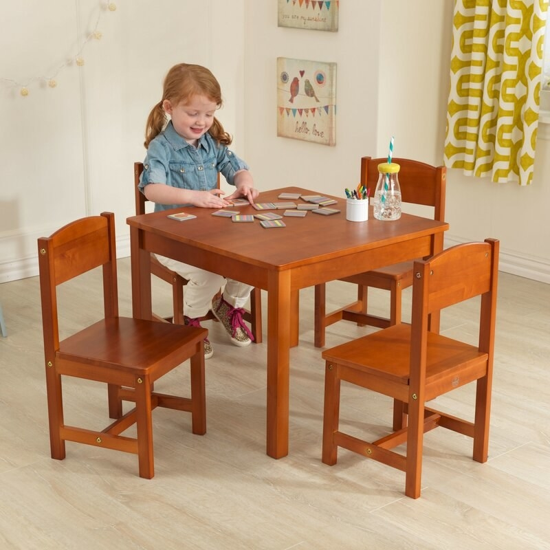 A child at the table in pecan