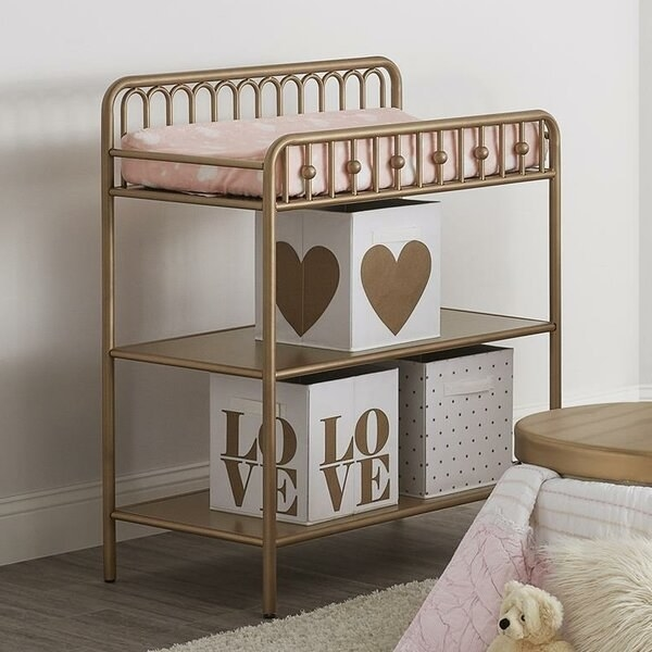 The gold-colored changing table