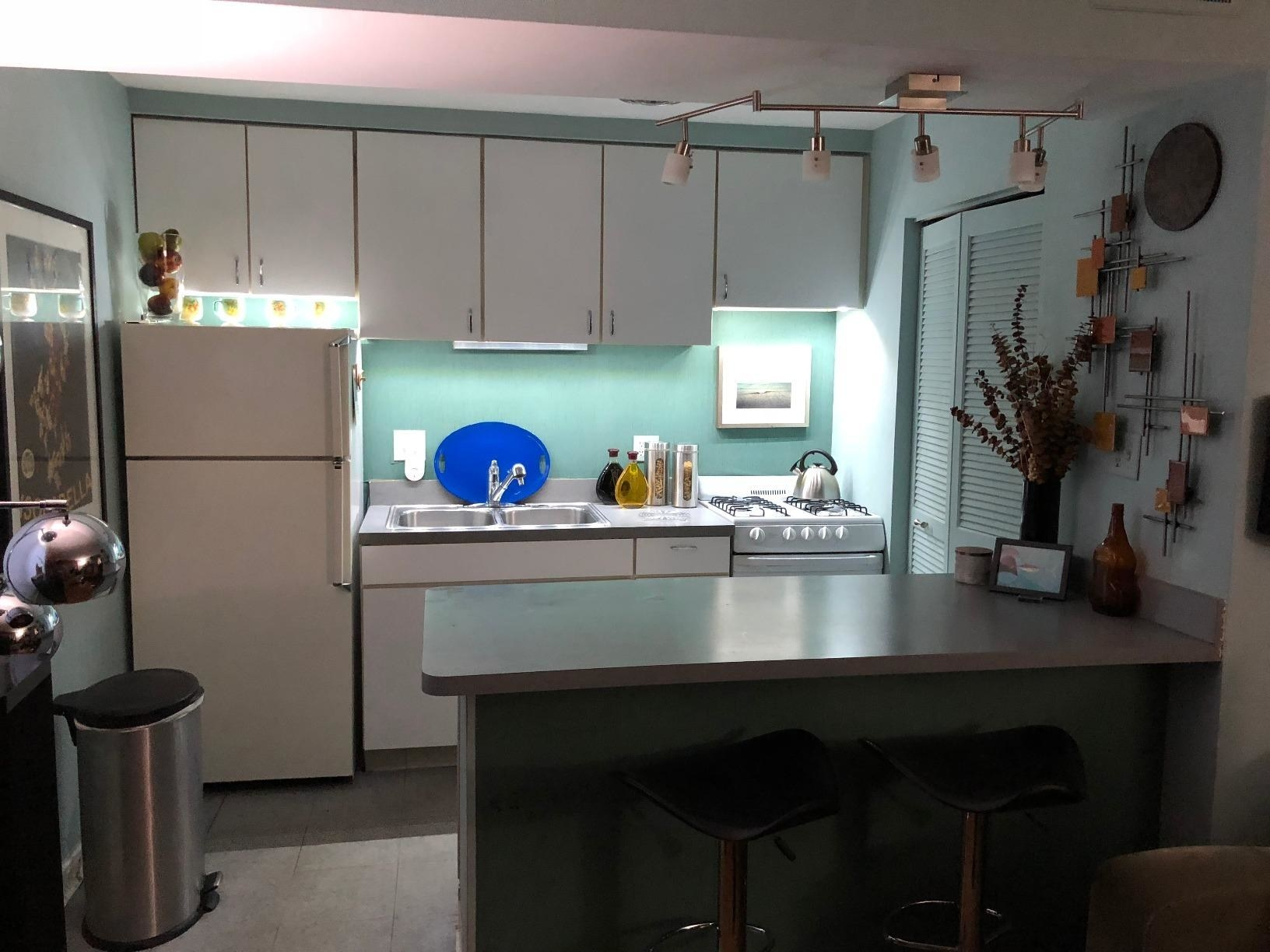 small kitchen with lights under the cabinet for a larger, brighter look