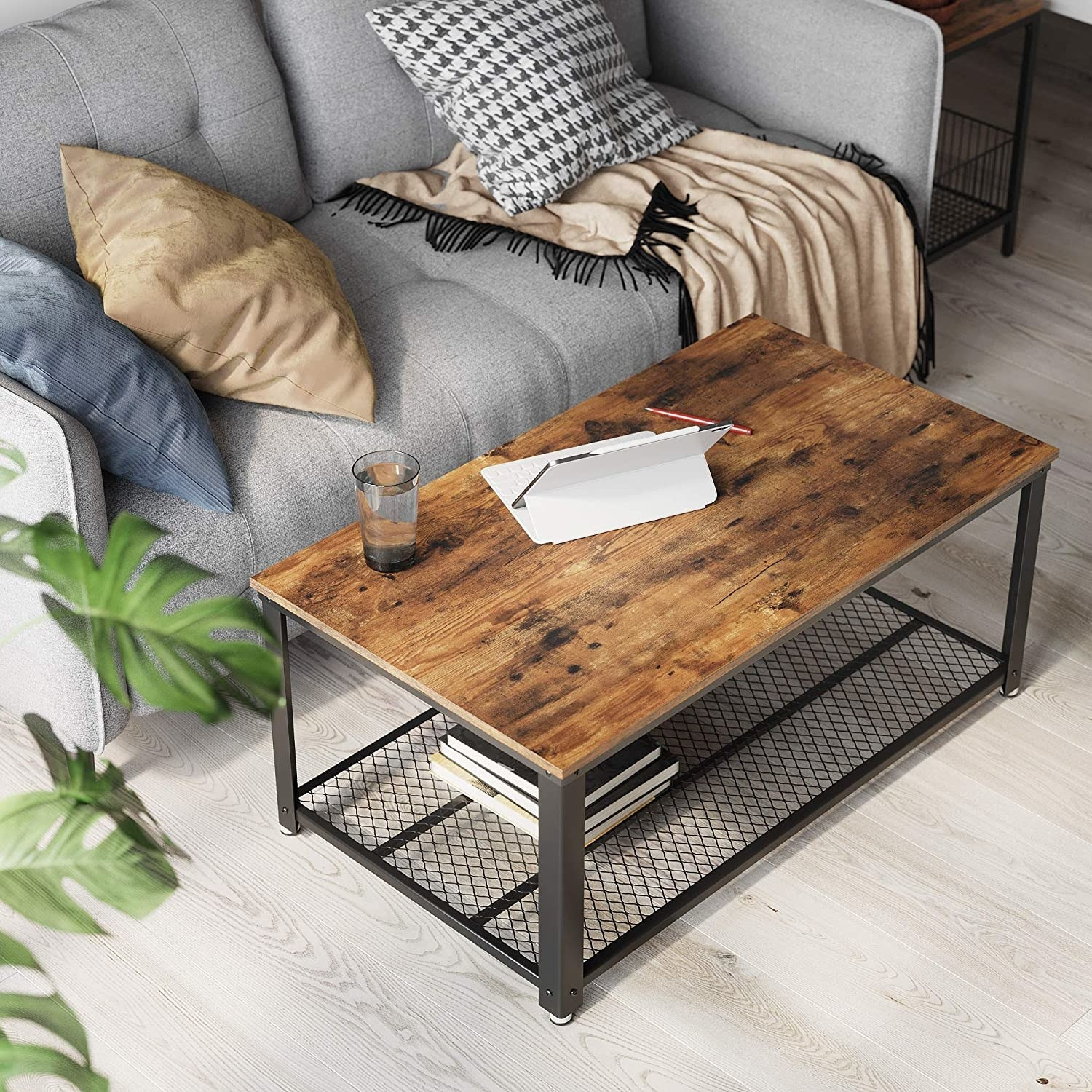 The coffee table in front of a couch with an iPad on it