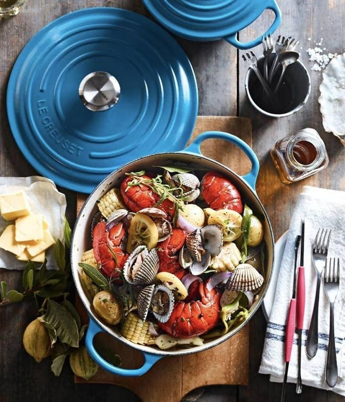 The cast iron dutch oven cooking a seafood dish