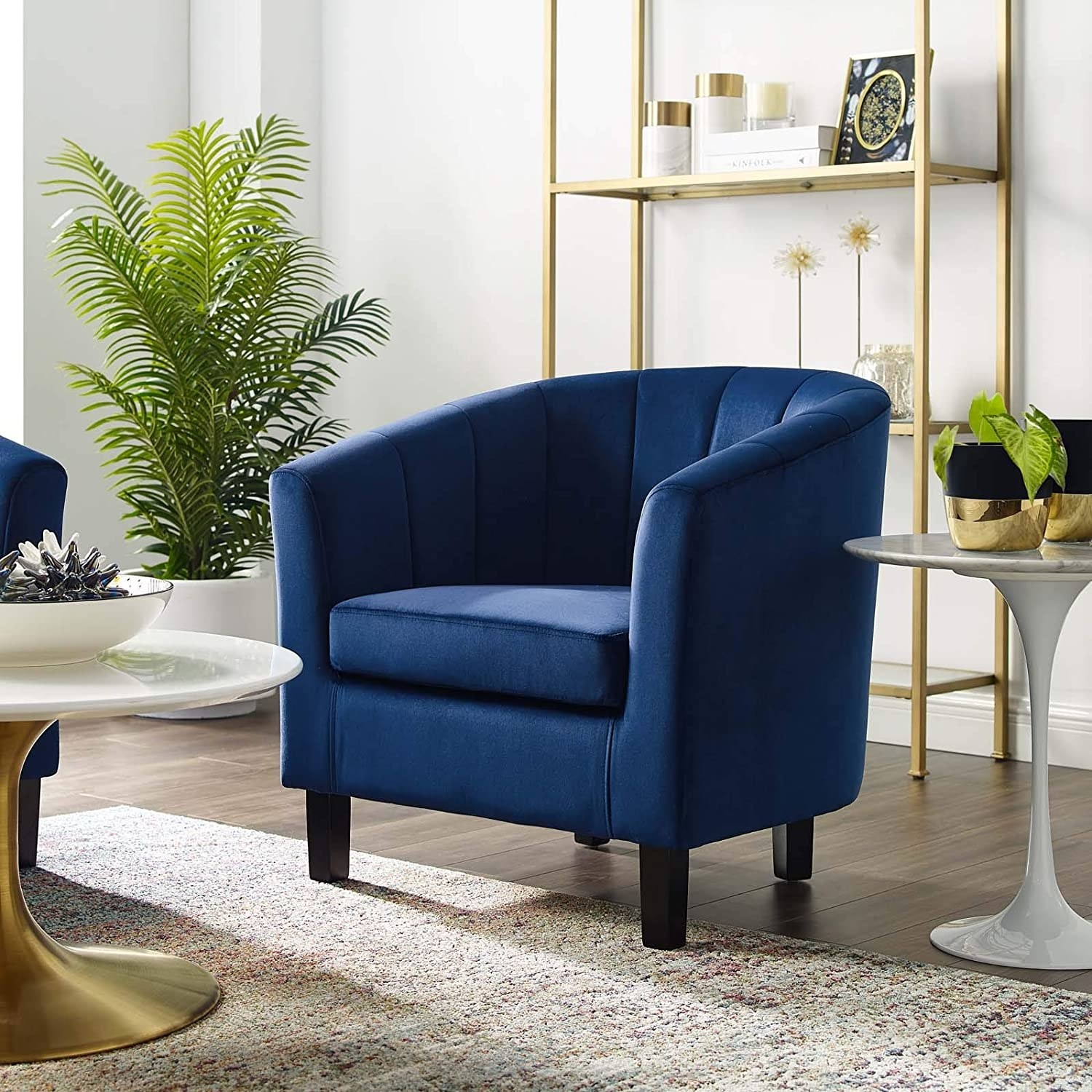 the navy modway tufted velvet armchair in a white and gold living space