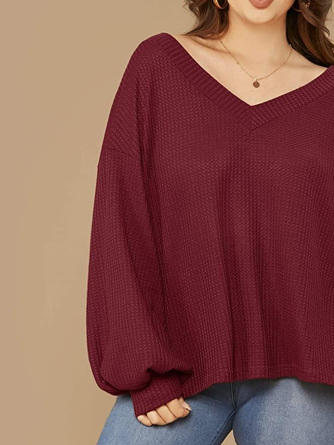 Model wearing the slouchy top in red