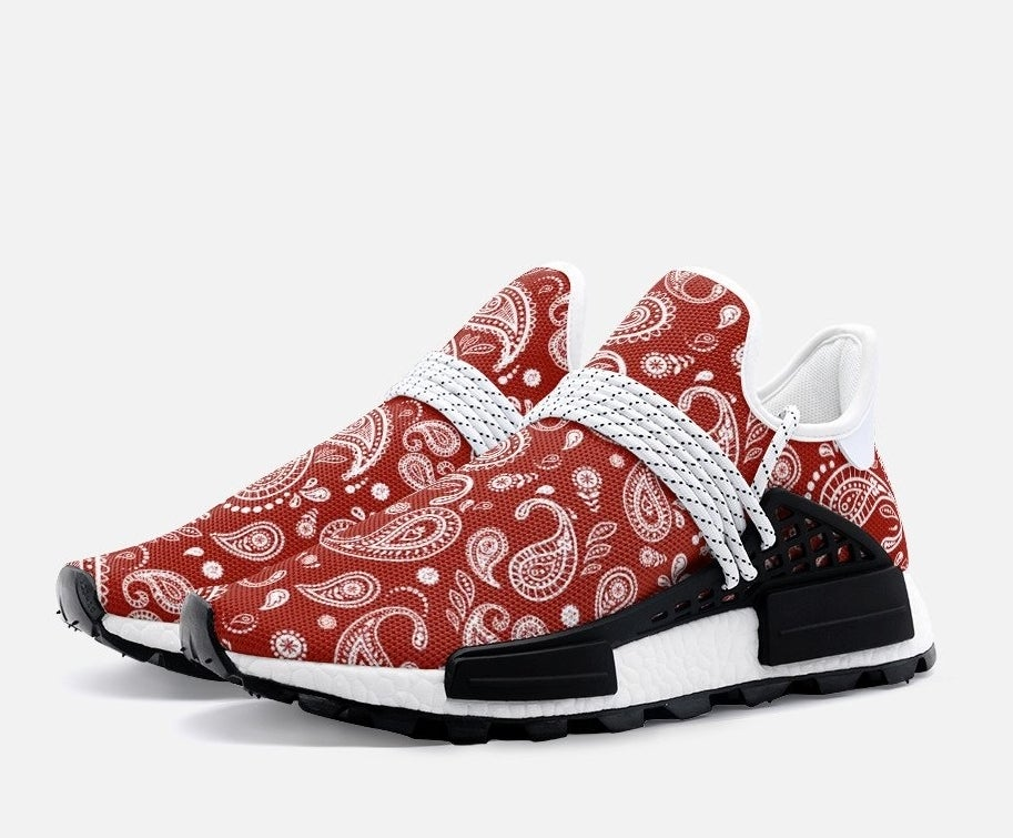 Slip on sneakers with decorative laces and a red bandana pattern