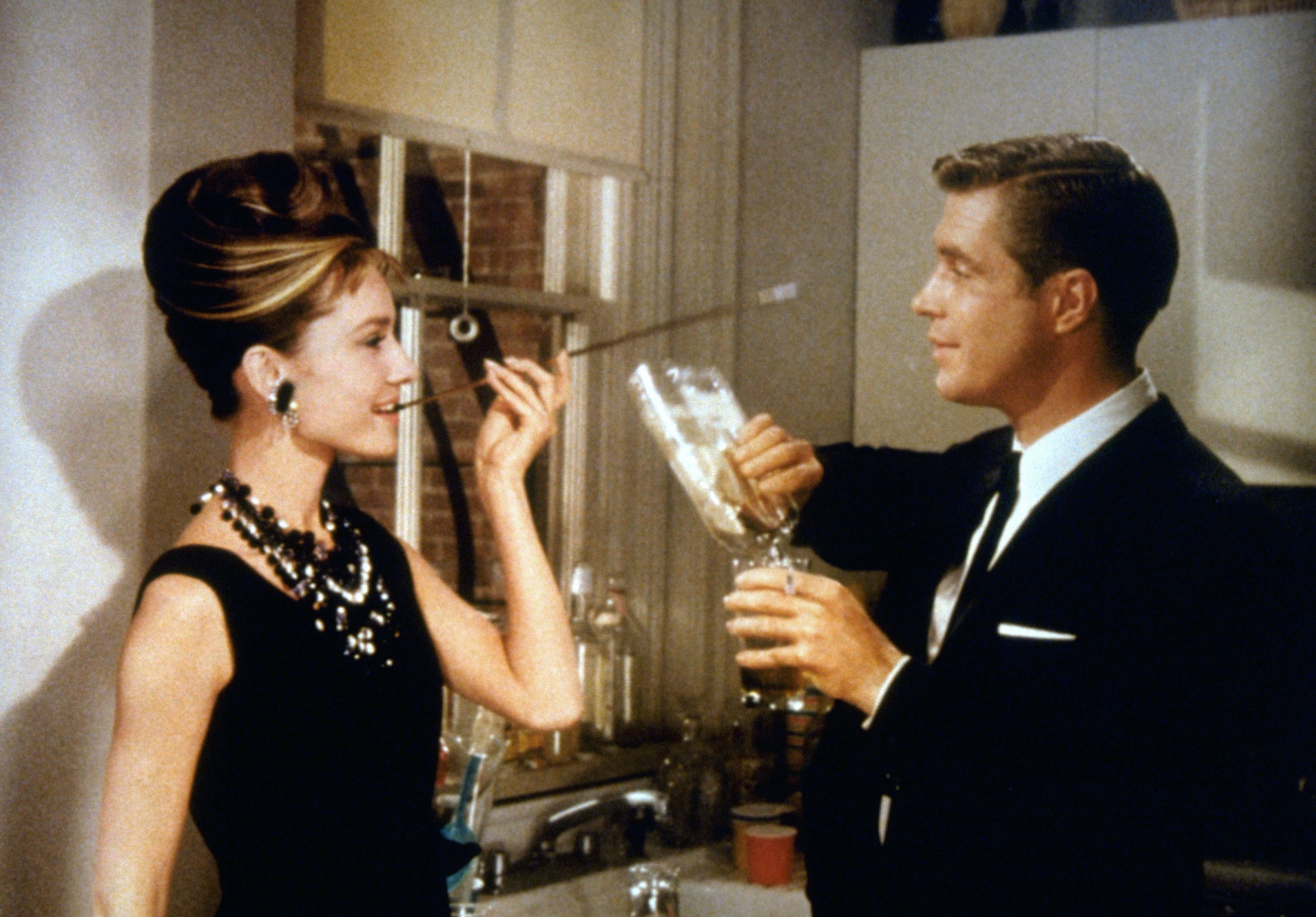 Paul and Holly enjoy a drink and a cigarette together