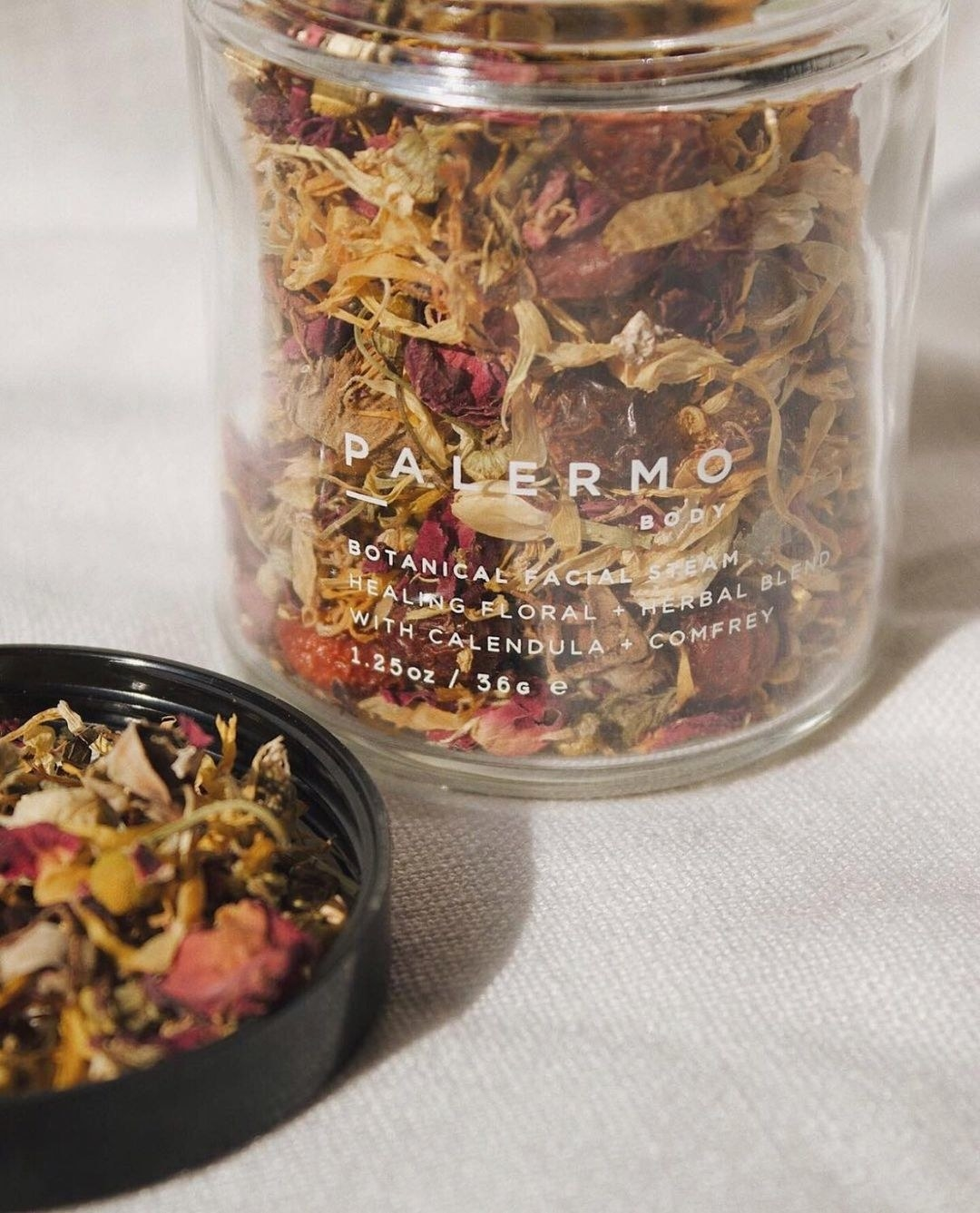 A close-up of the botanicals inside the jar