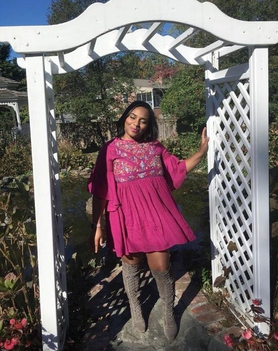 Reviewer wearing the floral dress in purple