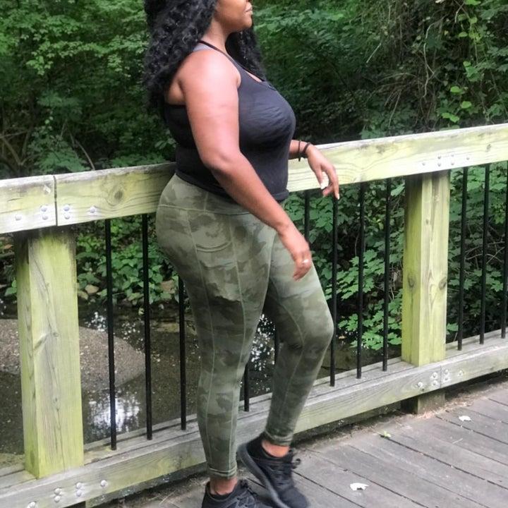 Reviewer wearing camo leggings