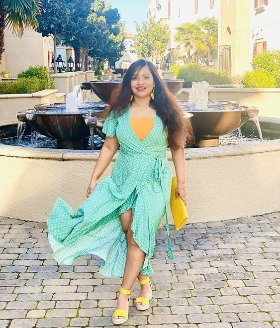 Reviewer wearing the wrap dress in green
