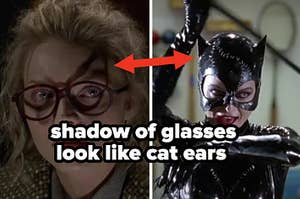 Michelle Pfeiffer as Selina Kyle AKA Catwoman wearing glasses that make a cat-like shadow on her face