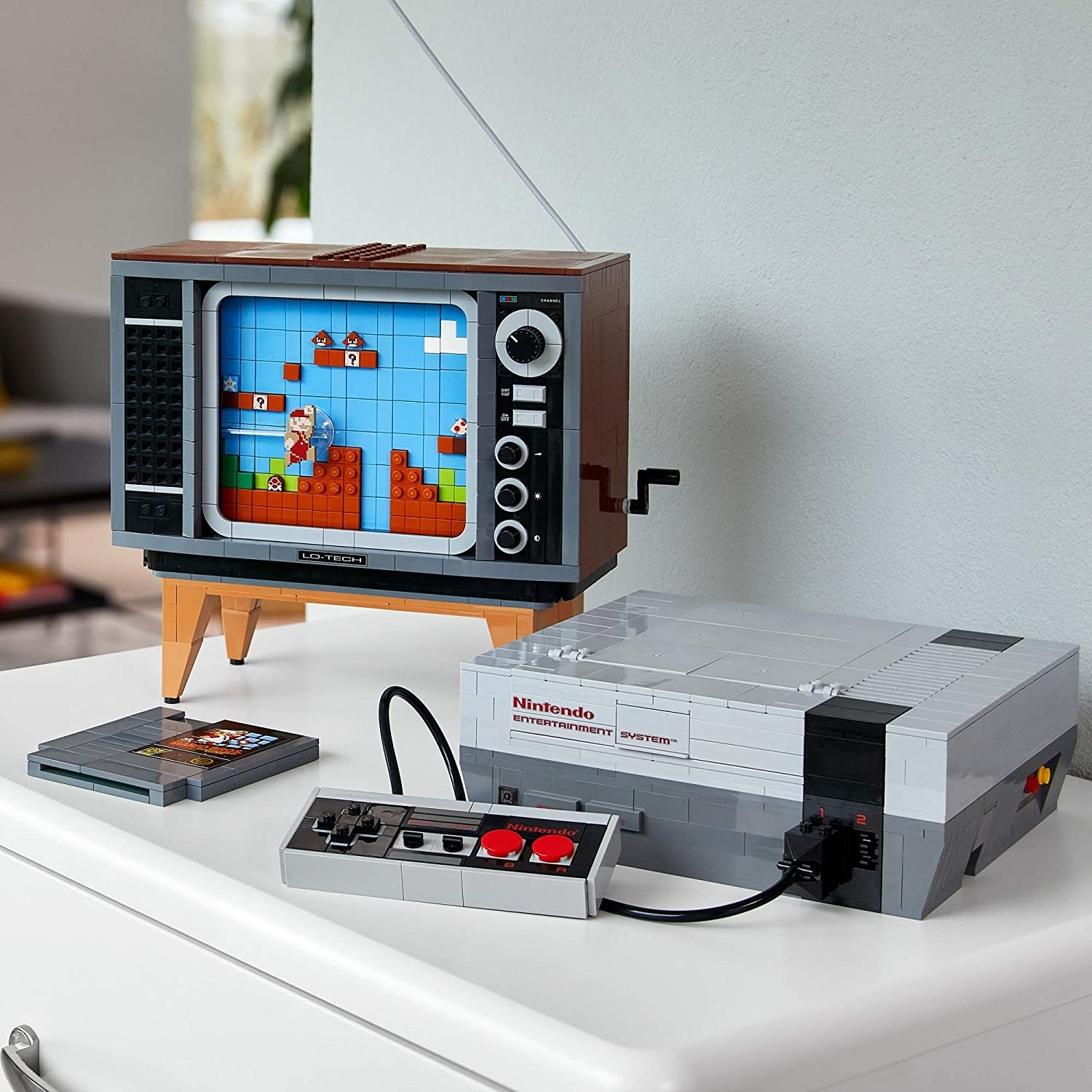 the lego NES system next to a lego tv and game cartridge