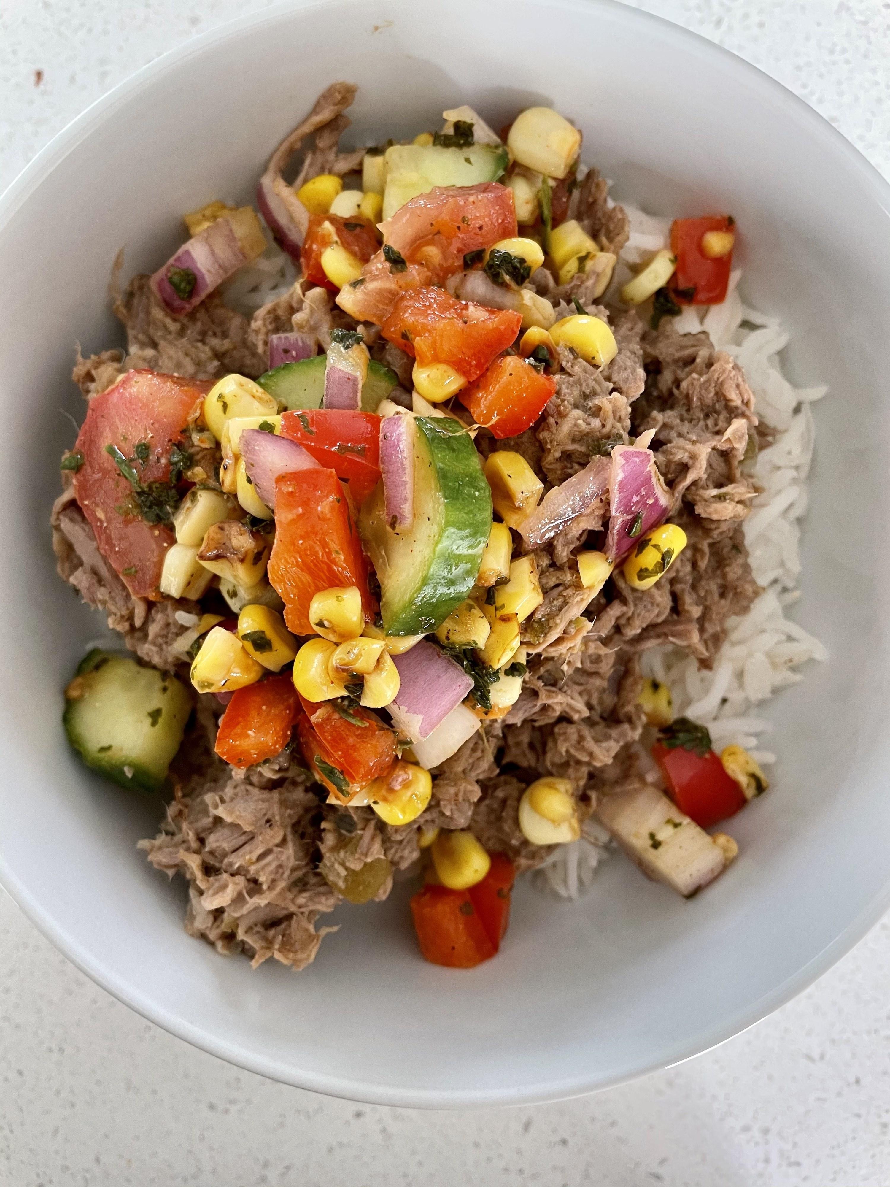 Burrito bowls plated with corn salsa