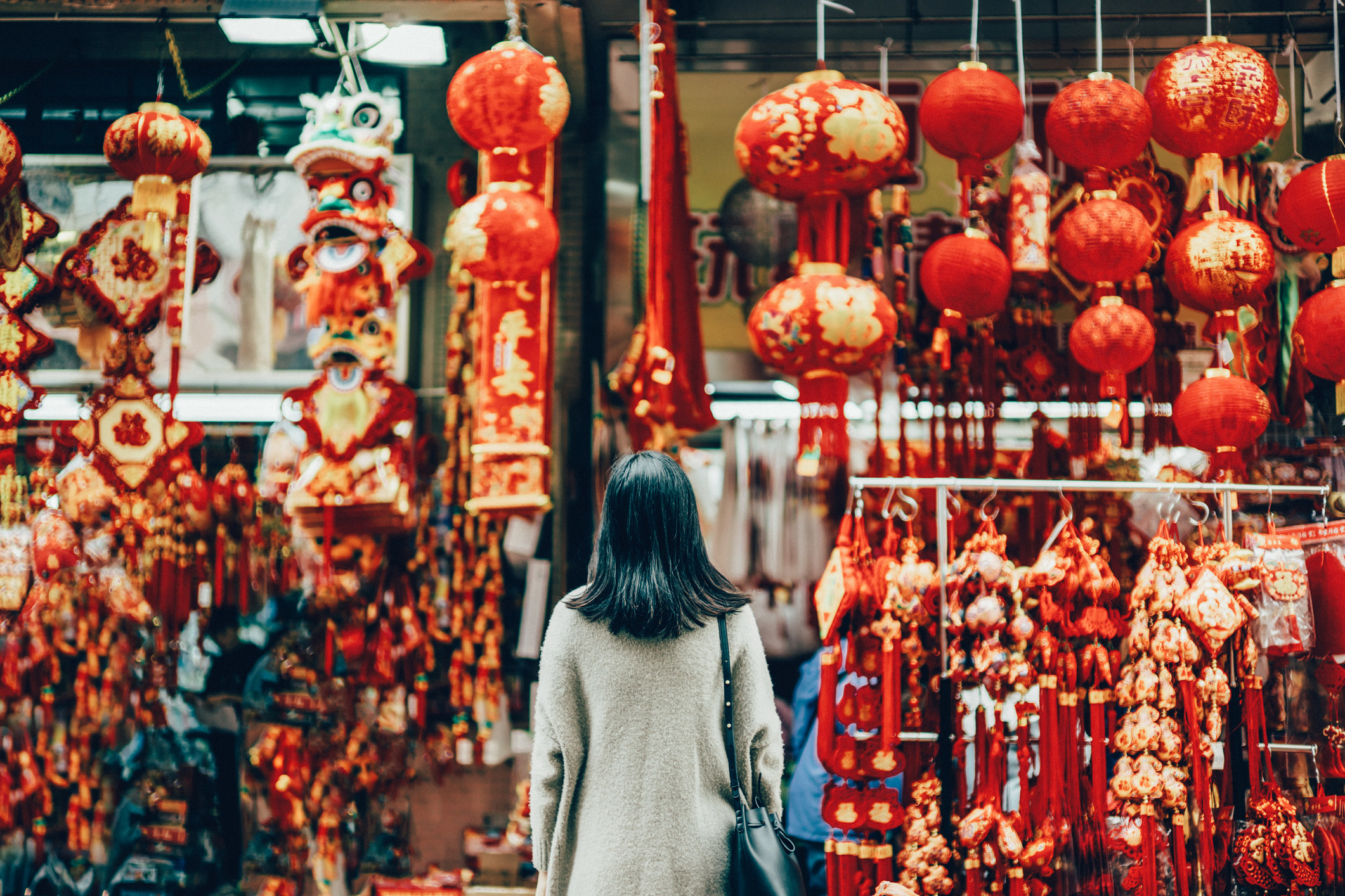 woman standing against Chinese New Year decorations and ornaments