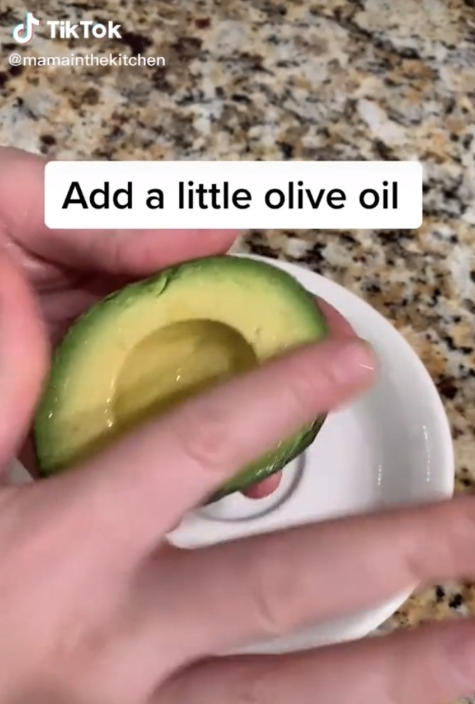 Rubbing a bit of olive oil onto an avocado