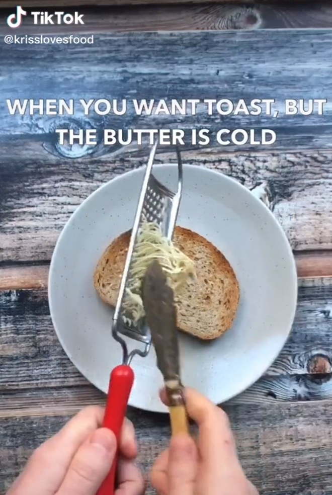 Butter being scraped from a cheese grater onto toast