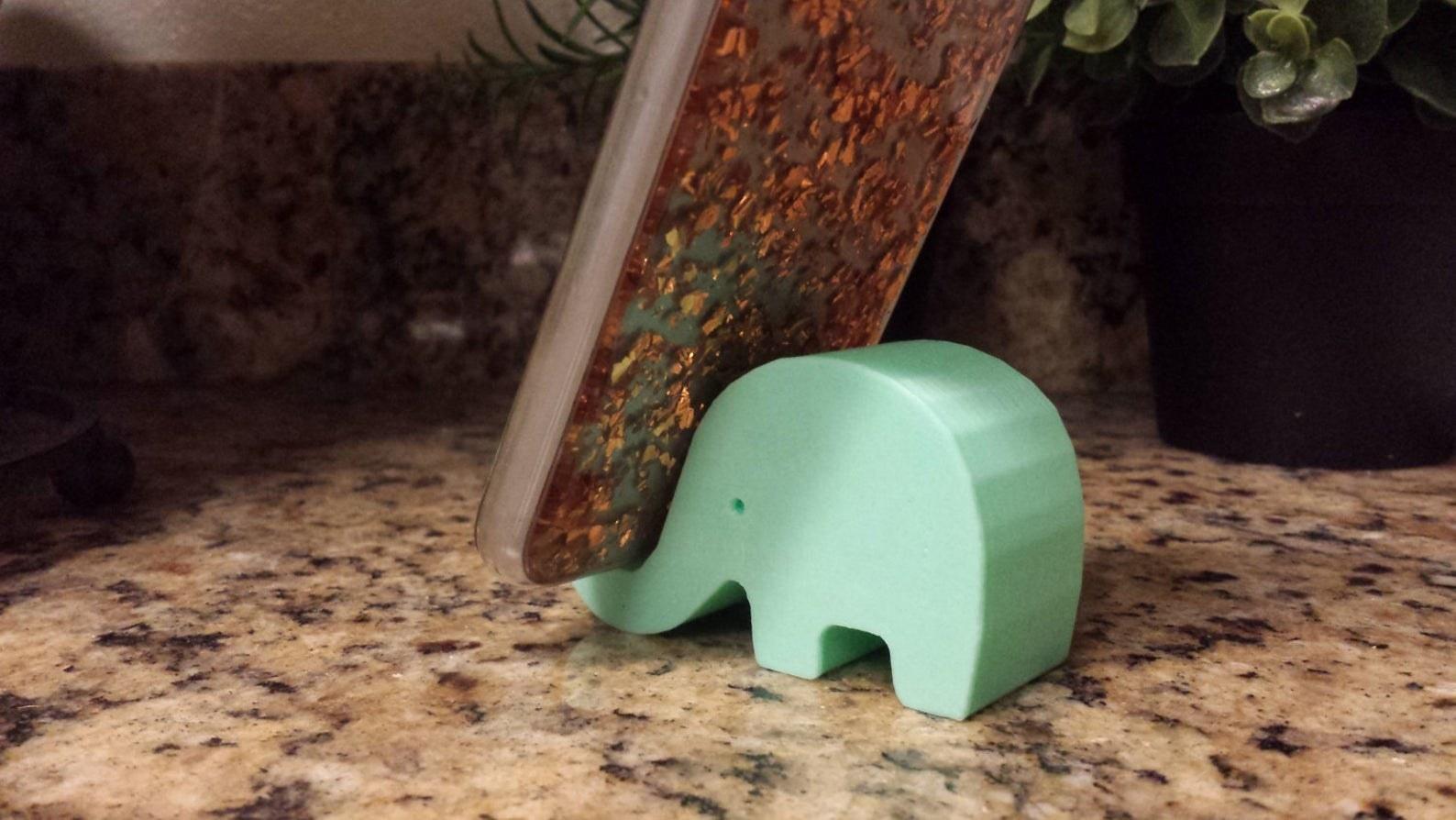 Elephant-shaped phone holder holding smartphone