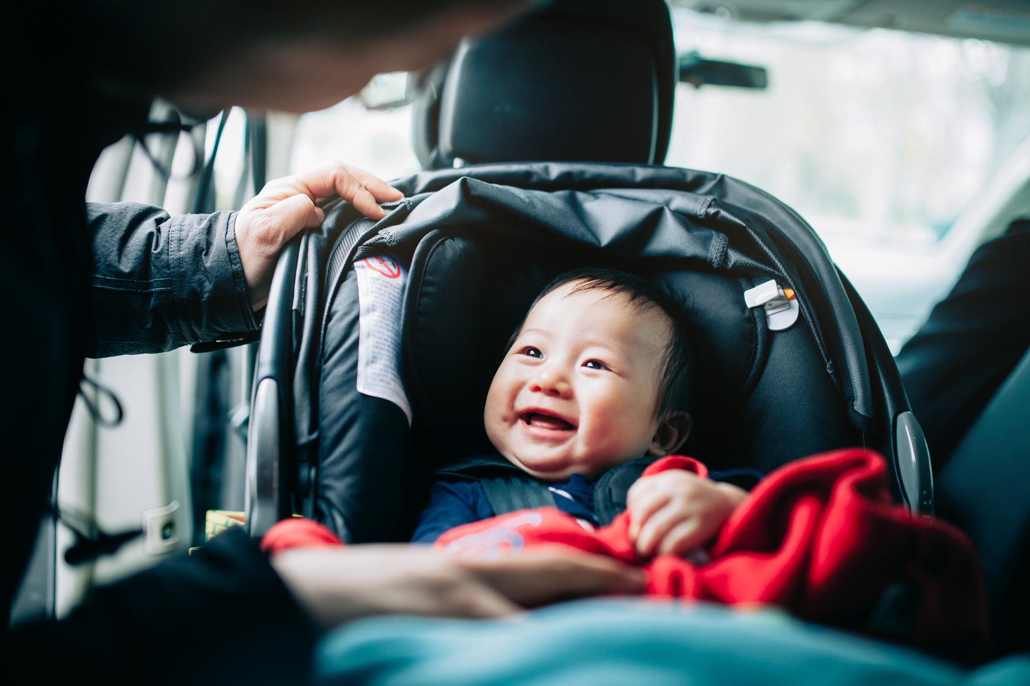 baby smiling in stroller