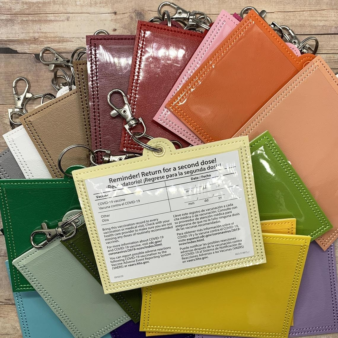 the holders in various colors, with a clear front to show the card and a keyring and large lobster clasp on the top