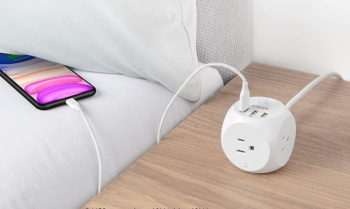 Charging cube with USB charger plugged in