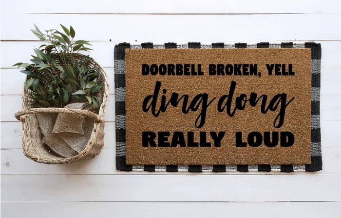"""Natural doormat with words in black that say """"Doorbell broken, yell ding dong really loud"""""""