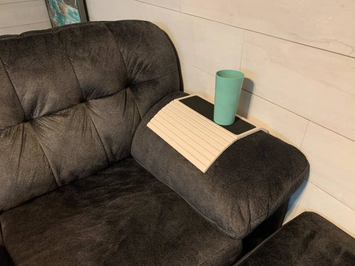 Couch table placed over arm rest