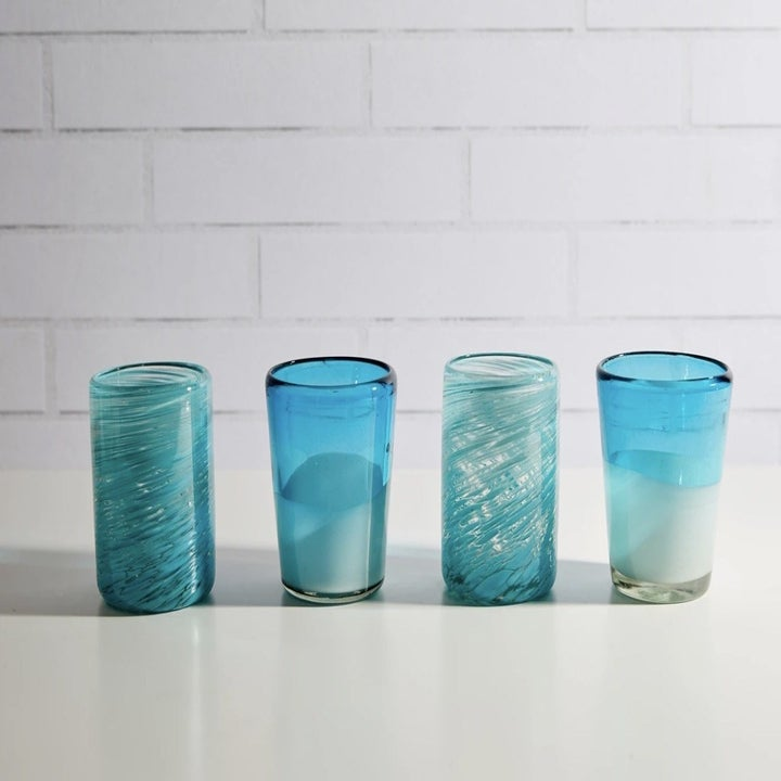 four blue and white glasses