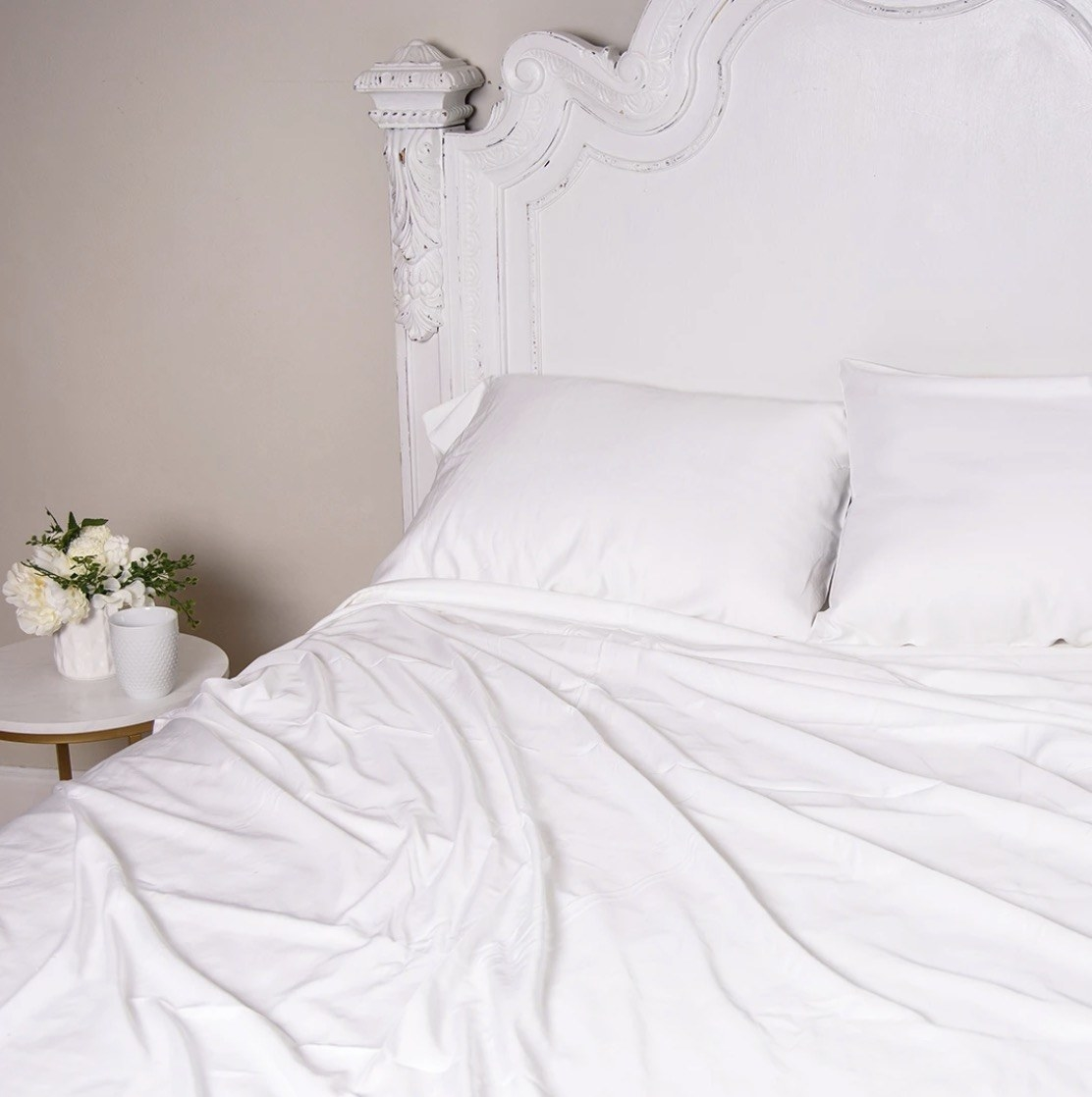 white sheets on a bed