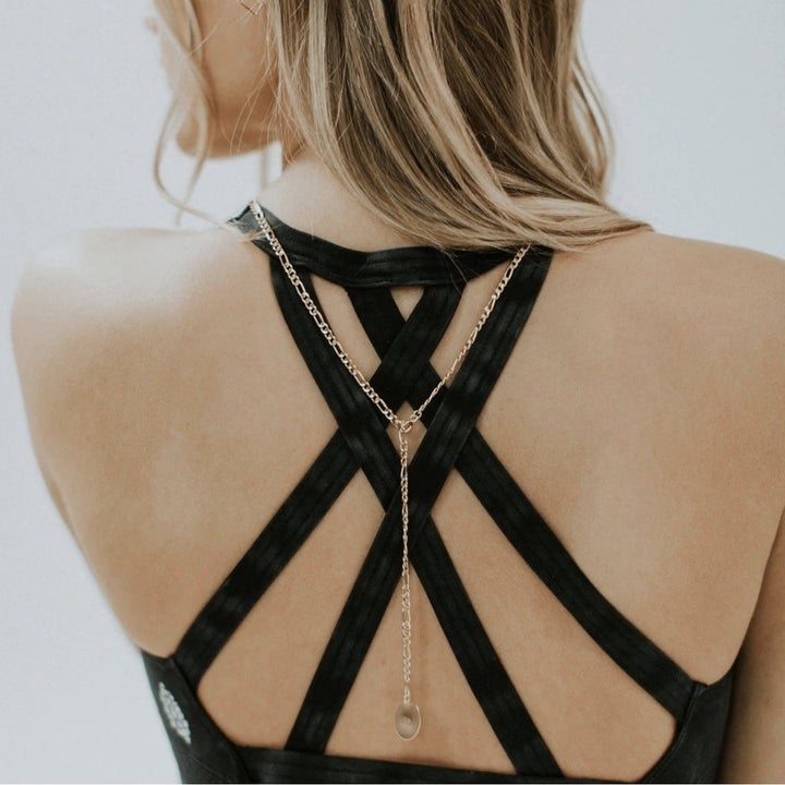 model wearing necklace draped down their back