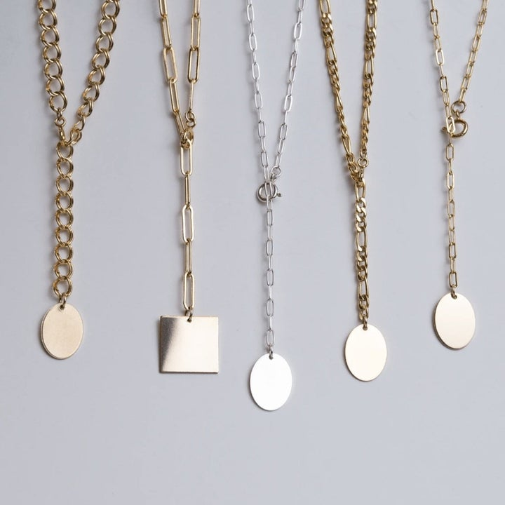 five styles of chain necklaces, each with a blank engrave-able pendant on the end
