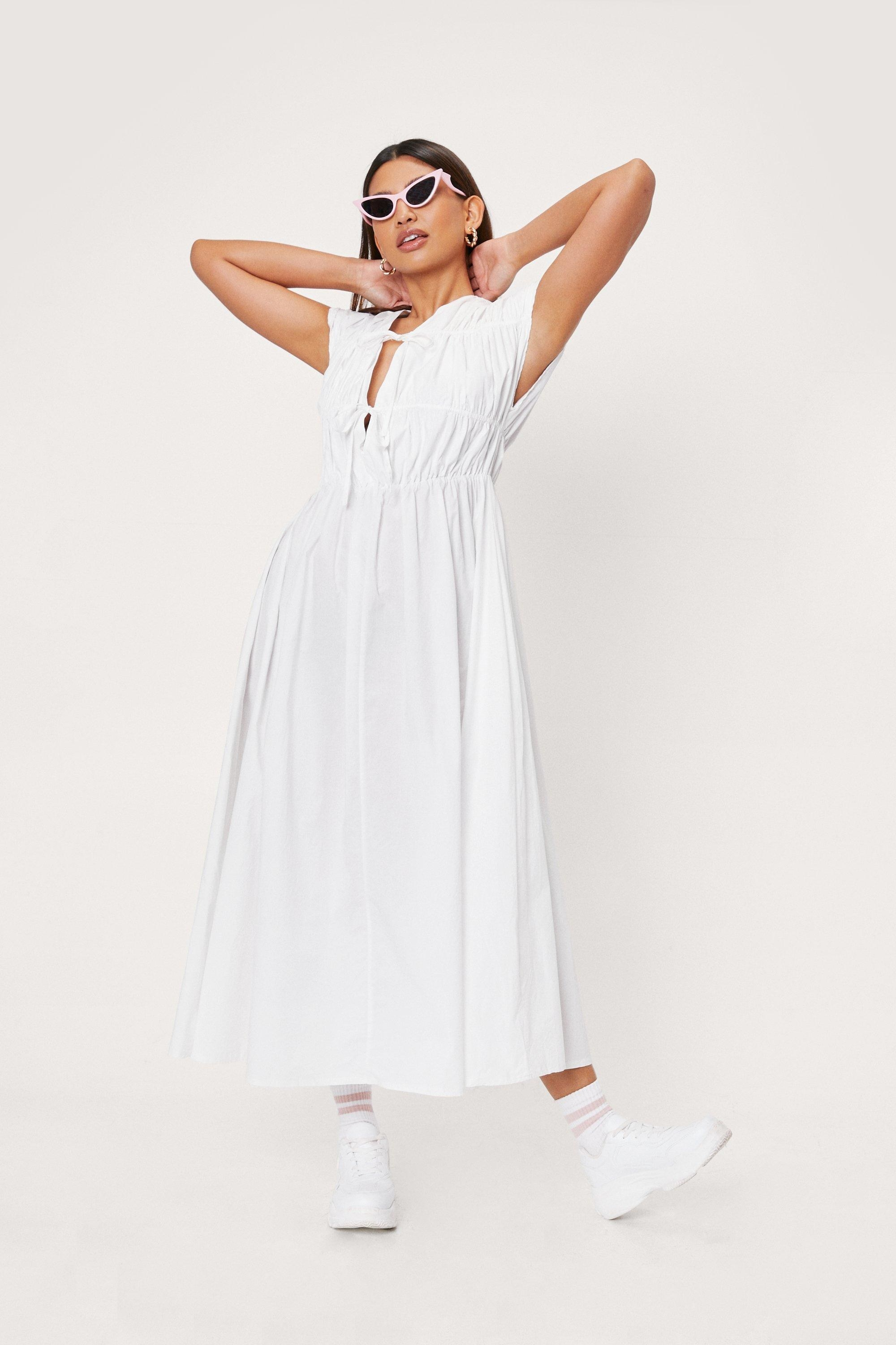 white midi dress with two bows on the front
