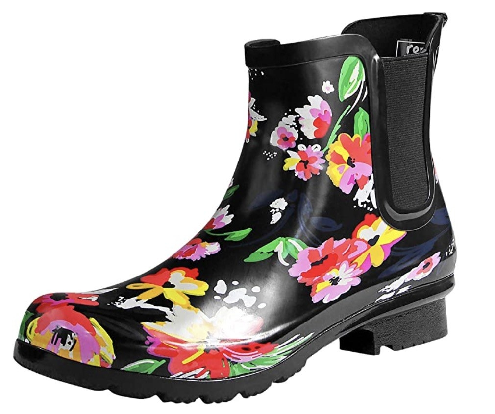 the black chelsea-style boots with pink, red, white, and yellow flower illustrations