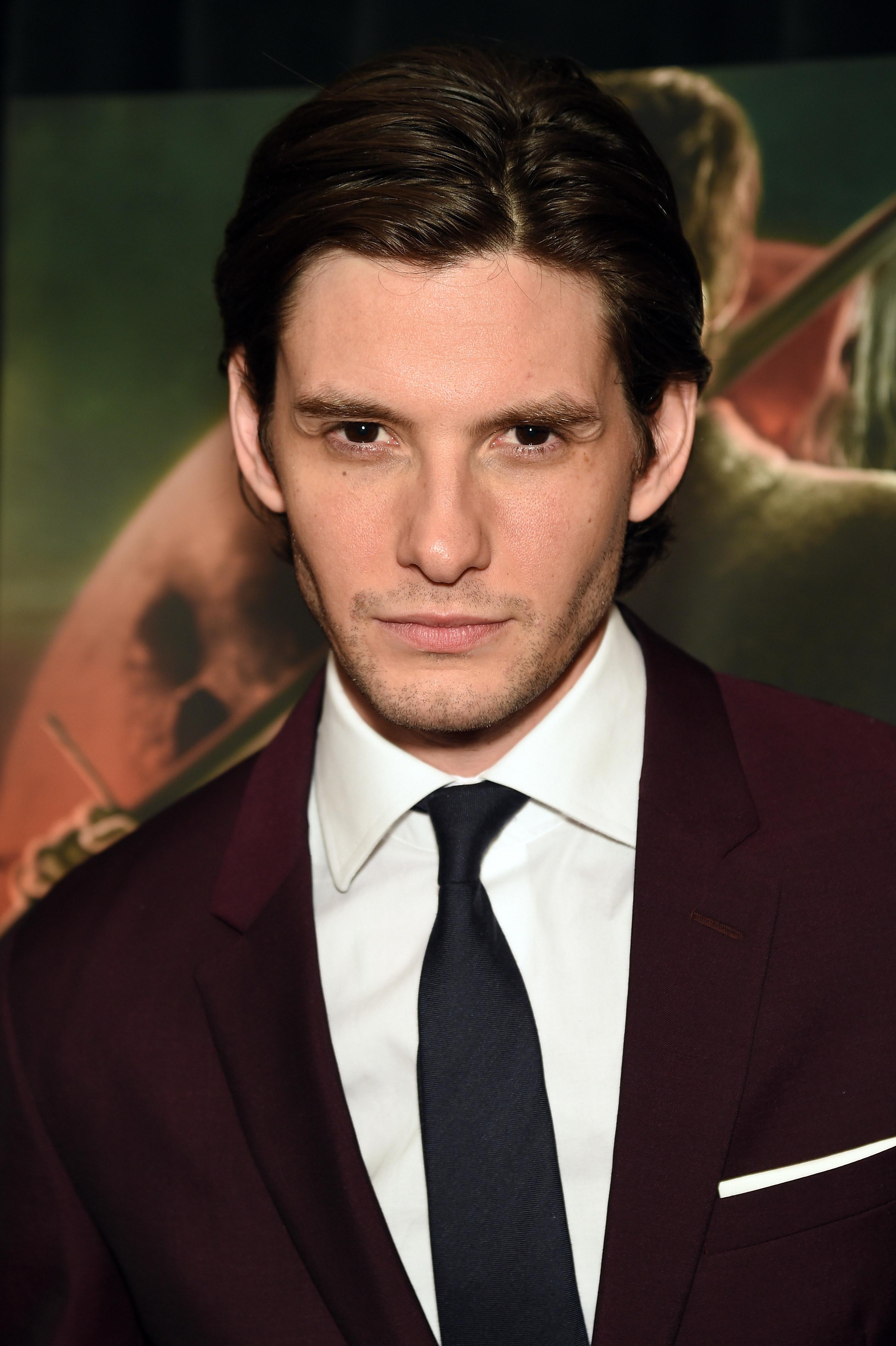 Ben Barnes in a suit and tie