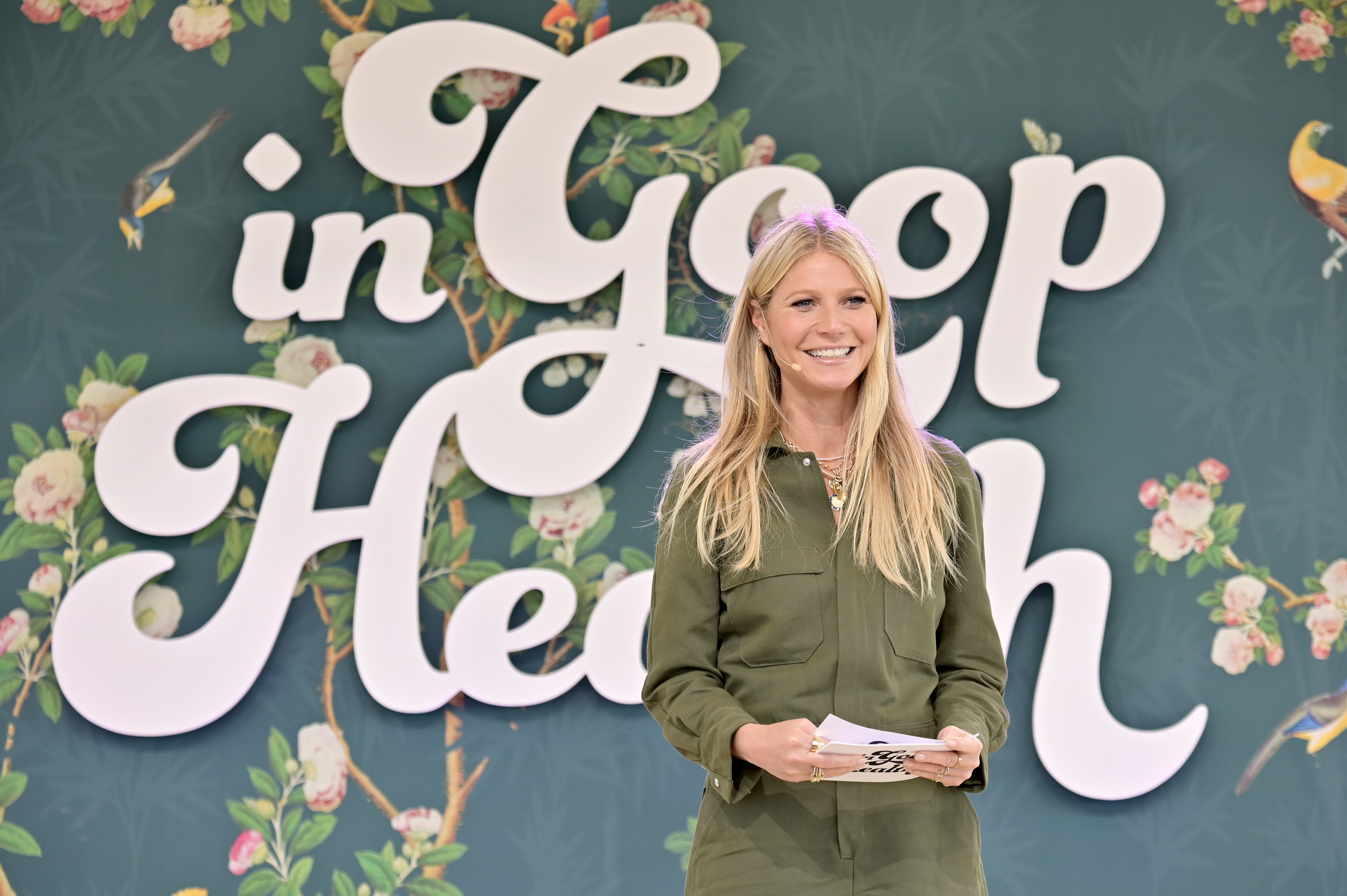 Gwyneth speaks onstage at a goop event