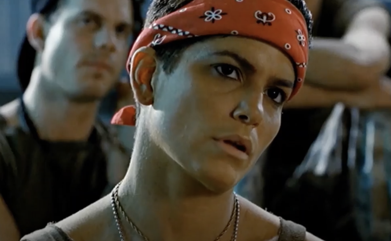 Jenette Goldstein as her character Vasquez wearing a bandana and tank top