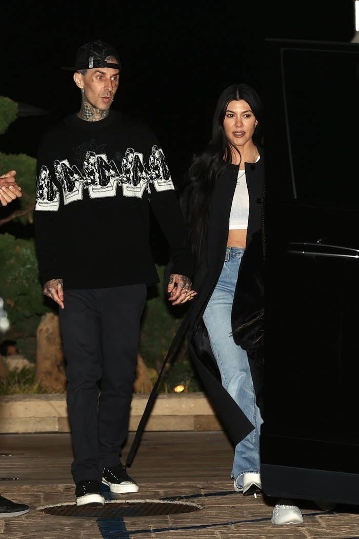 Travis Barker and Kourtney Kardashian in front of Nobu