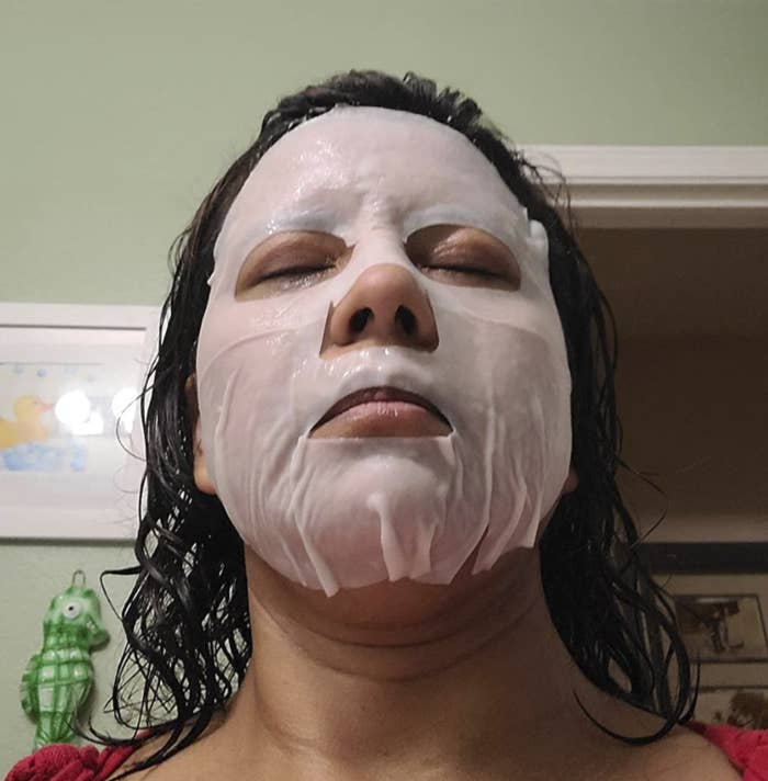 reviewer wearing one of the collagen face mask