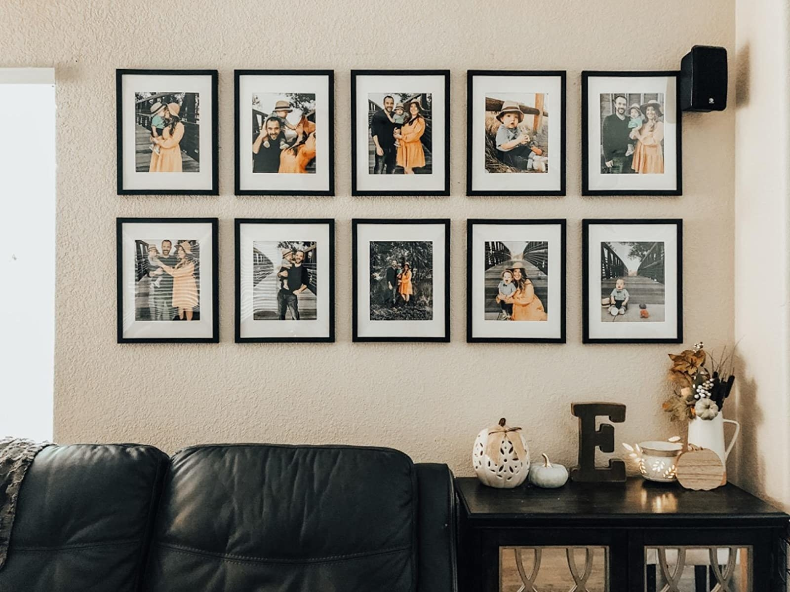 Reviewer's gallery wall created with black frames and white matting