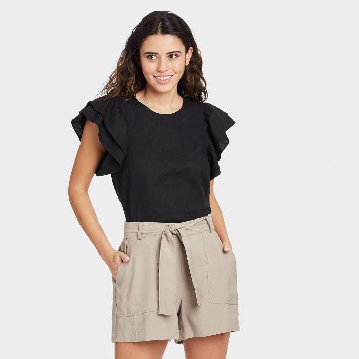 Model wearing black shirt