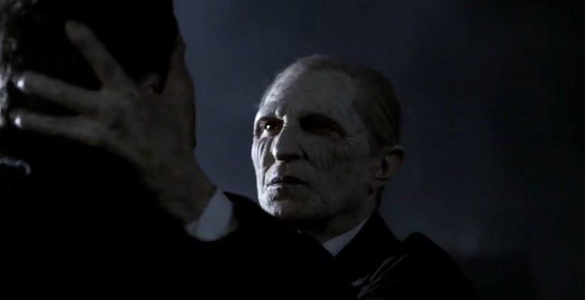A white-faced reaper grabbing Dean's head