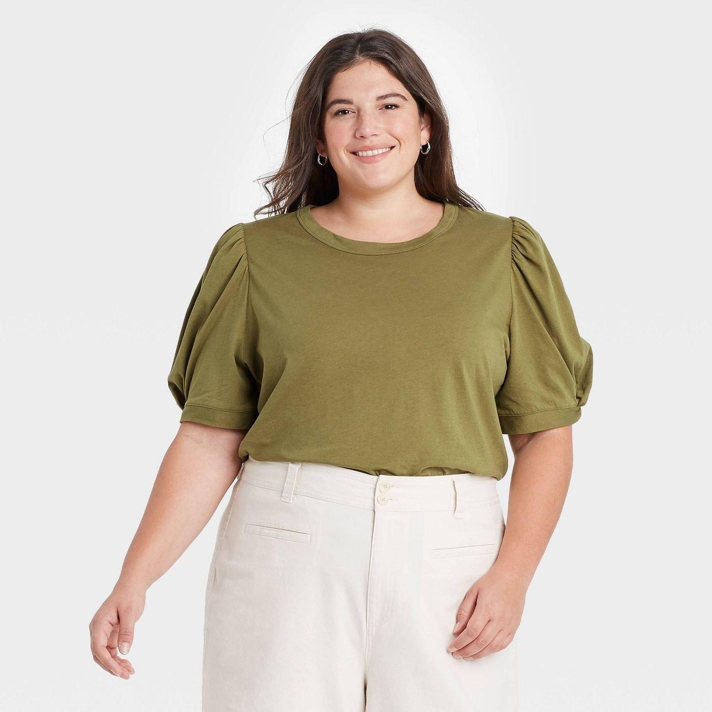 Model wearing green T-shirt top
