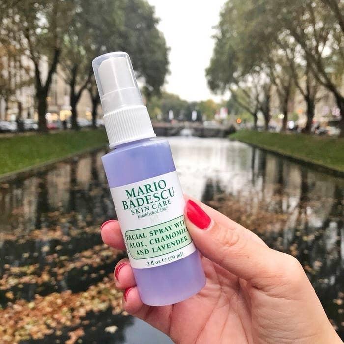 A person holding the Mario Badescu spray