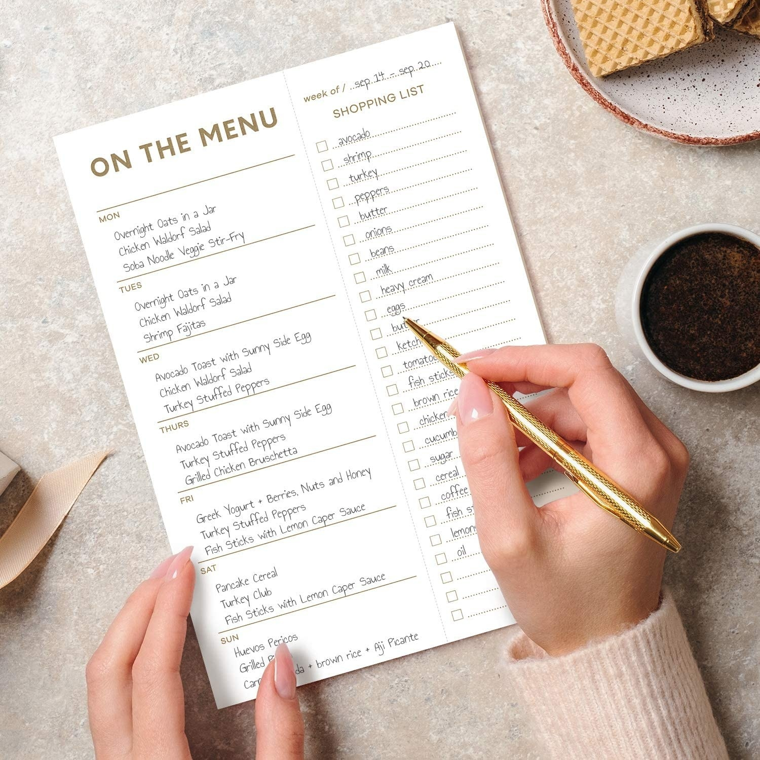 A person writing on the menu pad