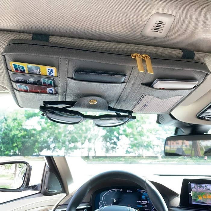 The pouch attached to a sun visor in a car