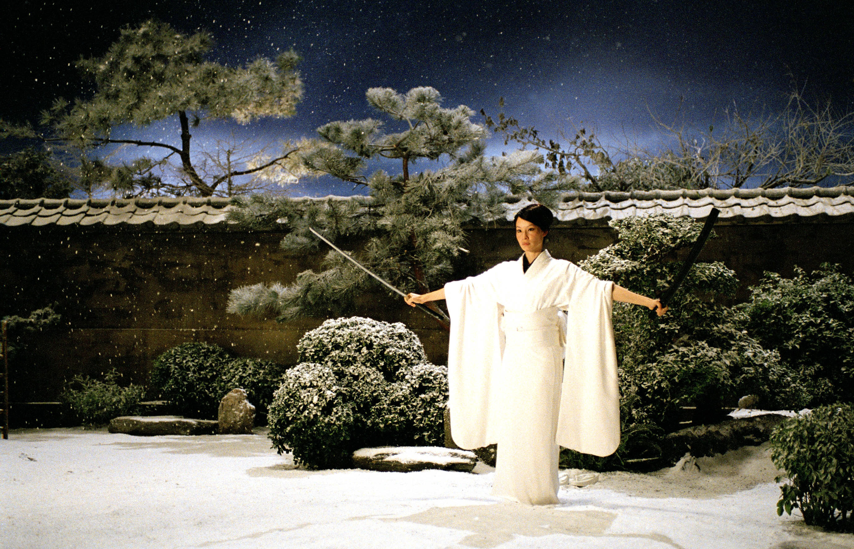 Liu stands in the snow with a sword in Kill Bill