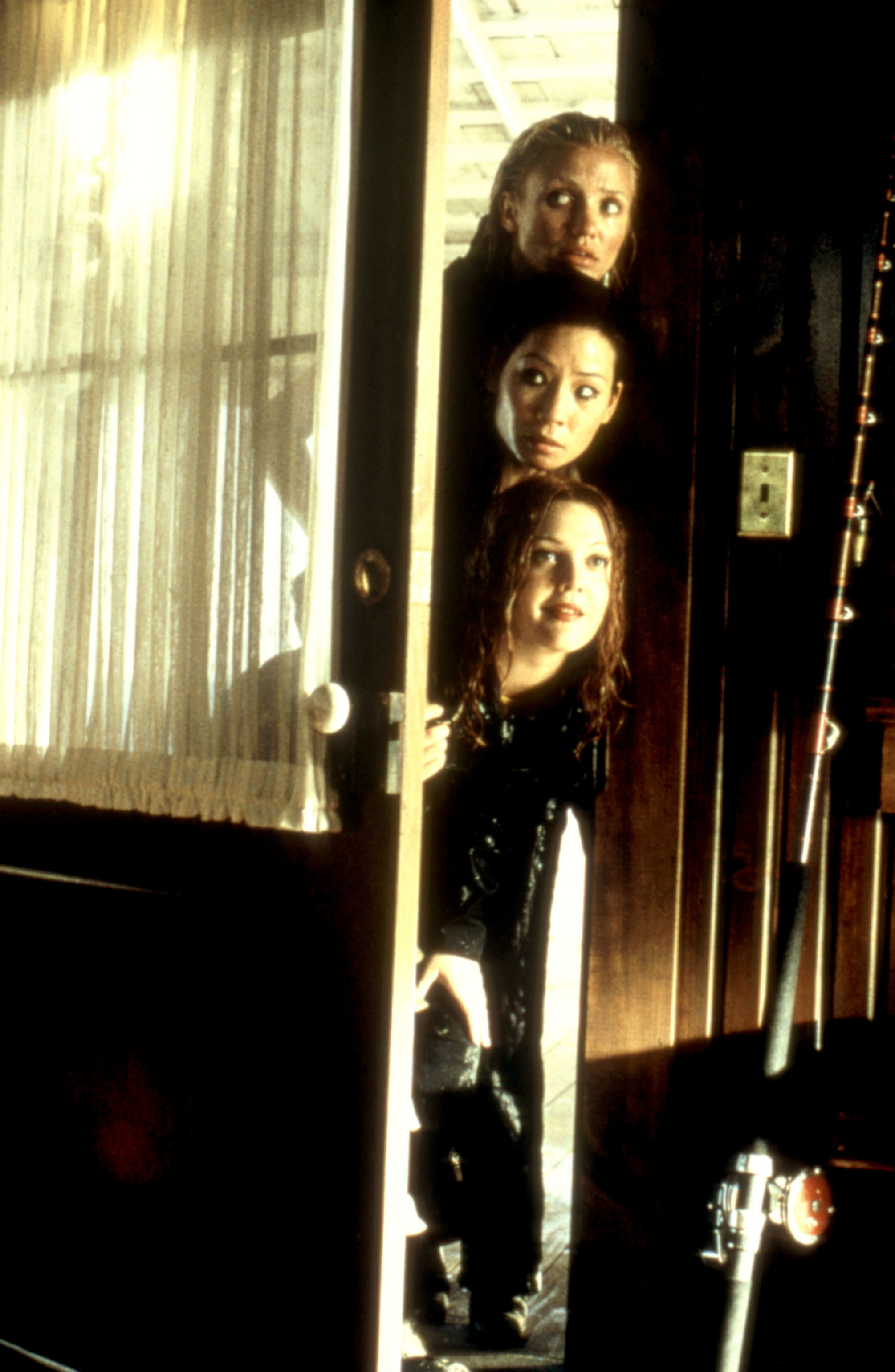 Barrymore, Liu, and Diaz break into a door in Charlie's Angels