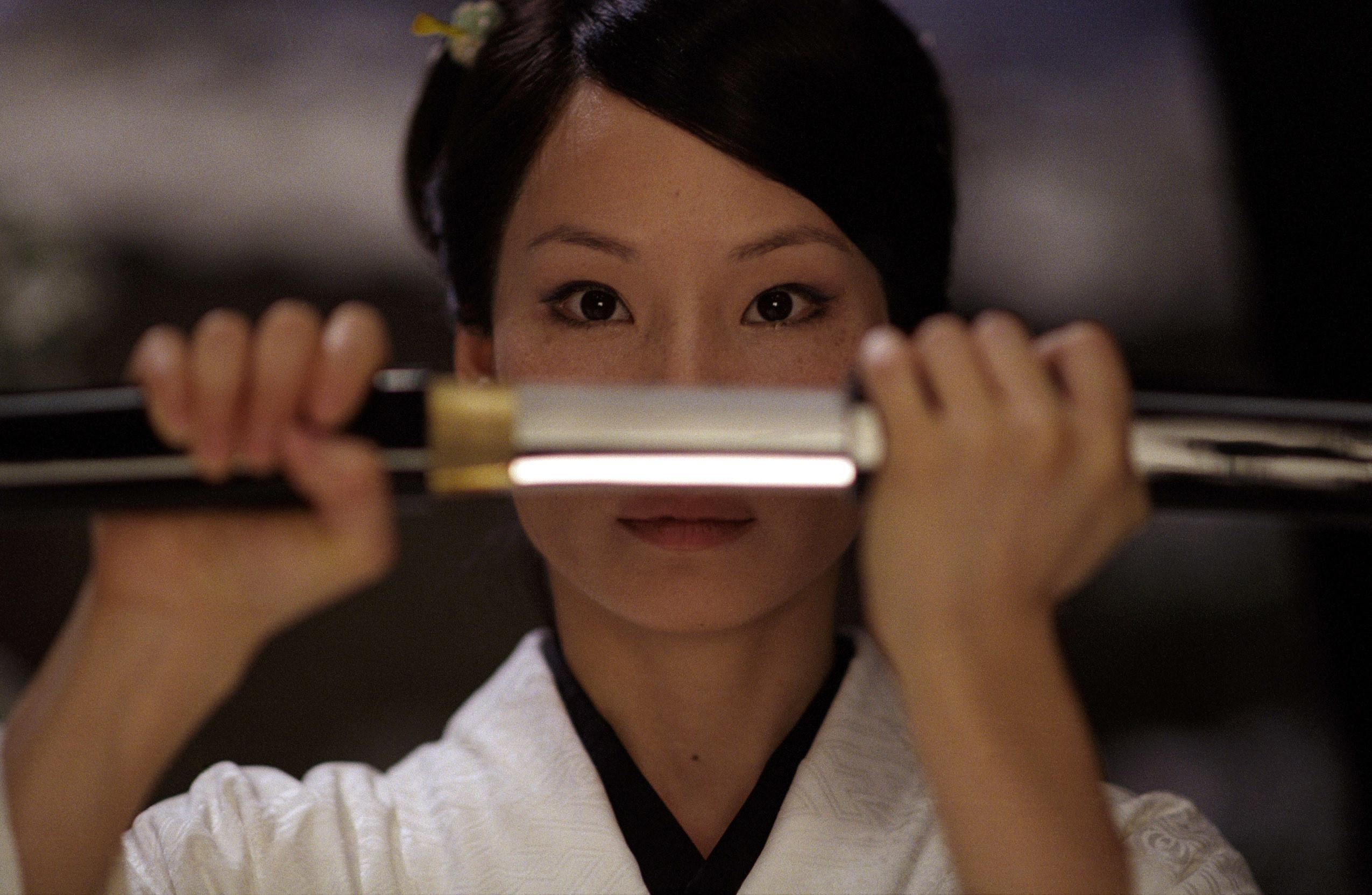 Liu unsheathes a sword in Kill Bill