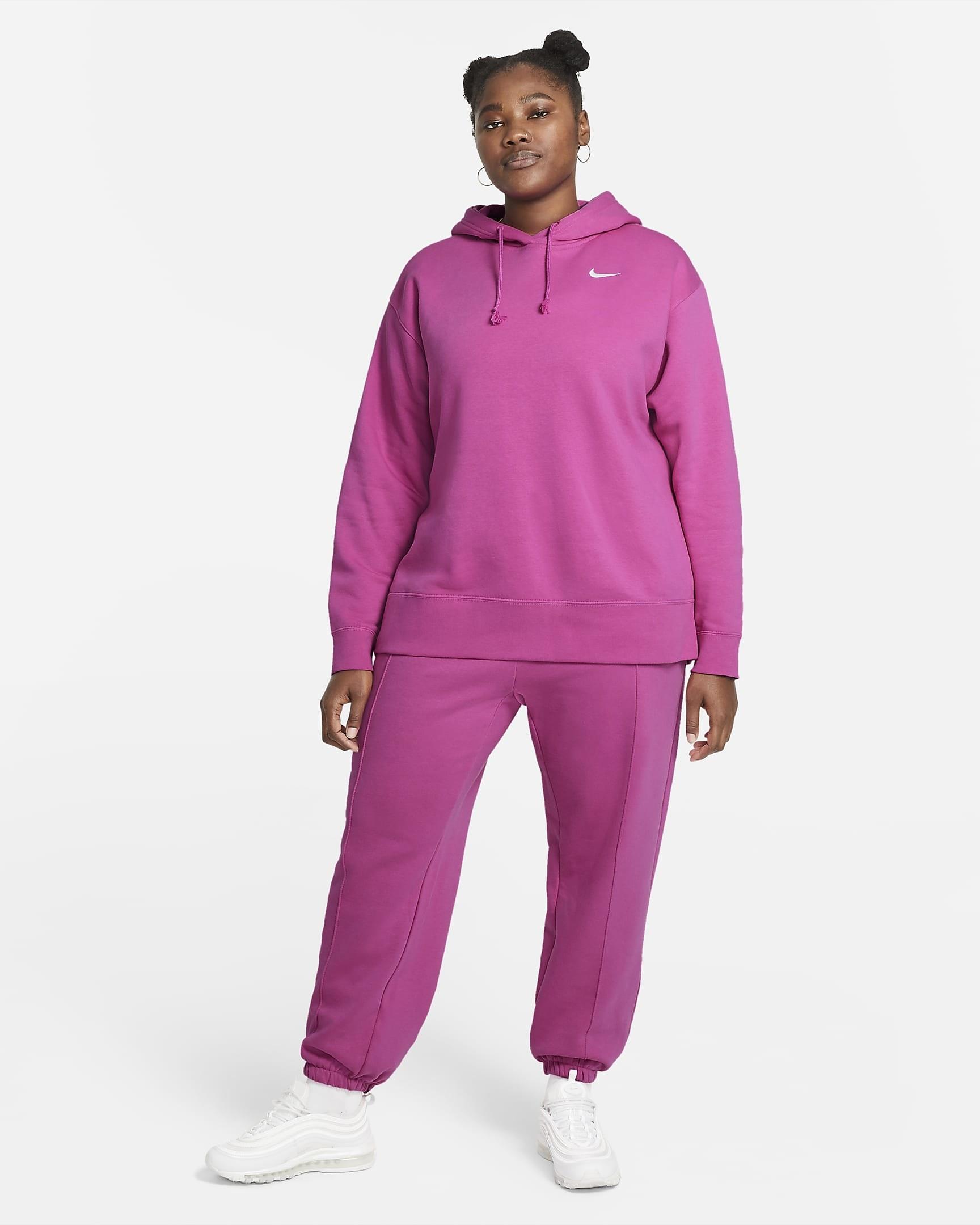 A person wearing a matching sweatshirt and sweatpants