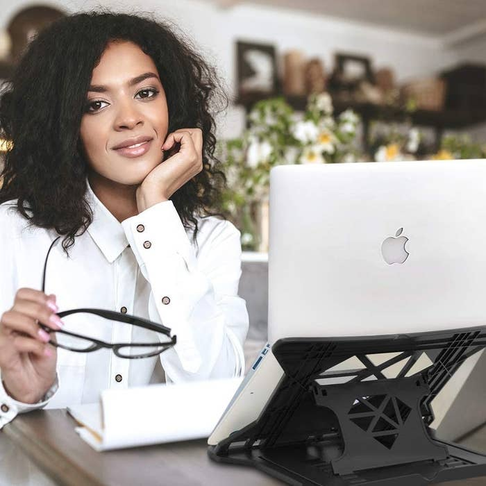 A woman with a laptop on the laptop stand