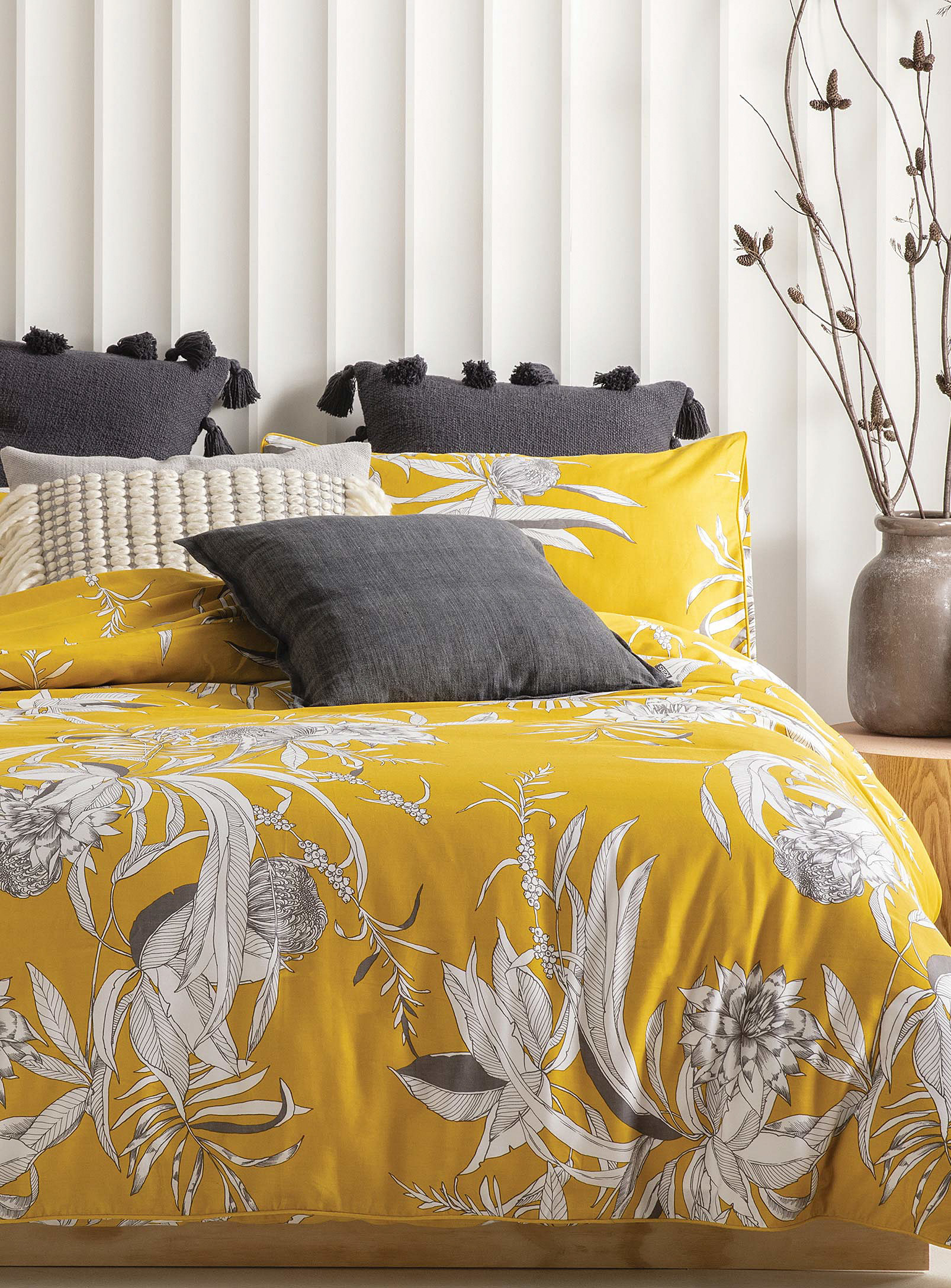 A duvet on a bed with a bunch of pillows