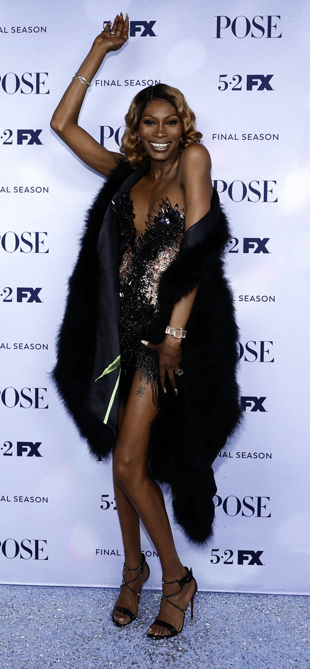 Dominique wore a strapless gown and a fur stole